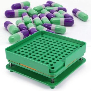 MICRO-DOSING CAPSULE MAKER/FILLING MACHINE WITH SCRAPPING TOOL